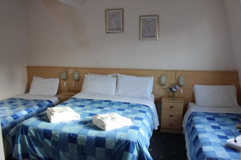 The Brooklyn Hotel family of 4 room one double bed and two single beds with blue bedding