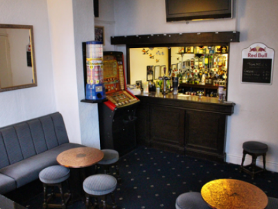 The Brooklyn Hotel bar area with a fruit machine and a seating area